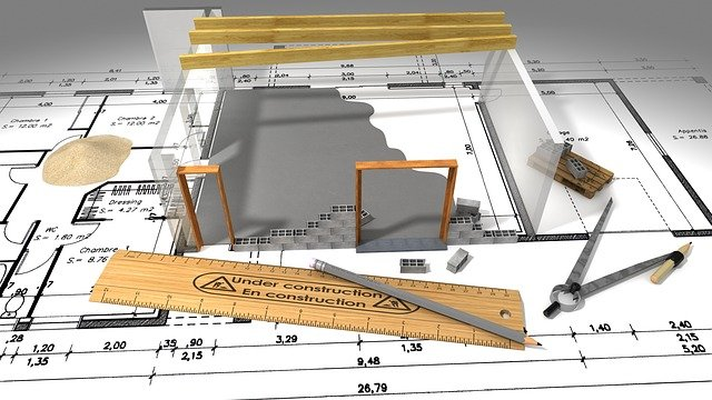 3d image of building in construction over a floorplan